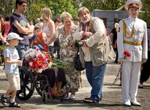Crowd congratulates veteran woman during Victory Day celebration Royalty Free Stock Photography
