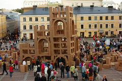 Crowd constructing cardboard skyscrapers at the Night of Arts festival in Helsinki, Finland Royalty Free Stock Photos