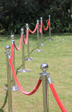 Crowd control barriers with red velvet rope Stock Photo