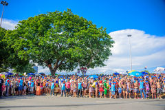 Crowd of costume people in blue sunhat in Flamengo Park waiting for Bloco Orquestra Voadora, Carnaval 2017 Royalty Free Stock Image