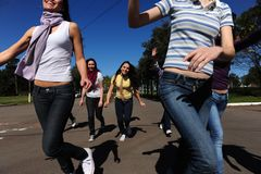 Crowd of crazy and happy teen girls running. Crowd of crazy fans running and screaming excited trying to catch a star royalty free stock photos