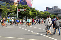 Crowd cross the street diagonally at center street view of taipei Royalty Free Stock Photo