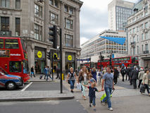 Crowd crossing Regent Street. On July 19, 2012, London, UK. Regent Street is the biggest shopping street in Europe, it's target of millions visitors in London Royalty Free Stock Images
