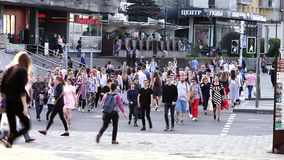 Minsk, Belarus, May 3, 2018: Crowd crossing urban street on a pedestrian crossing. Crowd crossing urban street on a pedestrian crossing stock footage