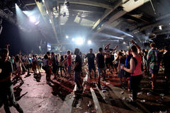 Crowd dance in a concert at Sonar Festival. BARCELONA - JUN 19: Crowd dance in a concert at Sonar Festival on June 19, 2015 in Barcelona, Spain Stock Photos