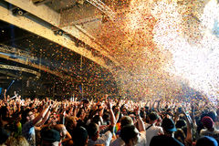 Crowd dance in a concert at Sonar Festival. BARCELONA - JUN 19: Crowd dance in a concert at Sonar Festival on June 19, 2015 in Barcelona, Spain Royalty Free Stock Images