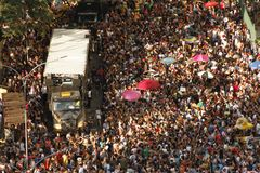 Street carnival in São paulo, Brazil. Crowd dancing around the `trio elétrico`, the typical sound truck of  street carnival at São Paulo, Brazil Stock Image