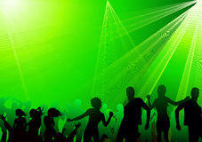 Crowd dancing in club. Green burst Stock Photos