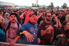 Crowd dancing at hip hop concert. BONTIDA, ROMANIA - JULY 18, 2018: Crowd of people having fun at a Delinquent Habits hip hop concert during Electric Castle stock photos