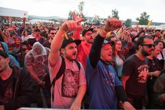 Crowd dancing at hip hop concert. BONTIDA, ROMANIA - JULY 18, 2018: Crowd of people having fun at a Delinquent Habits hip hop concert during Electric Castle royalty free stock photo