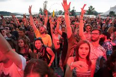 Crowd dancing at hip hop concert. BONTIDA, ROMANIA - JULY 18, 2018: Crowd of people having fun at a Delinquent Habits hip hop concert during Electric Castle royalty free stock photography