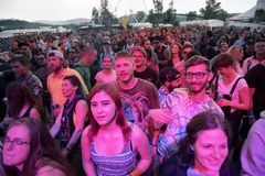 Crowd dancing at hip hop concert. BONTIDA, ROMANIA - JULY 18, 2018: Crowd of people having fun at a Delinquent Habits hip hop concert during Electric Castle royalty free stock images