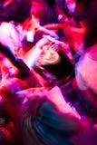 Crowd dancing in the nightclub. Blury people silhouetes dancing in the crowded nightclub royalty free stock photo