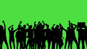 A crowd of dancing people, all in silhouette, on a greenscreen.
