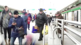 Crowd descends stairs in center of Gostiny Dvor metro station, long exposure. Saint-Petersburg, RUSSIA - January 20, 2018: crowd descends stairs in the center of stock video footage