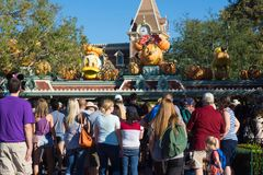 Crowd at Disneyland Entrance Halloween Theme. Disneyland entrance gates decorated for Halloween. Crowds line up for early morning admission Royalty Free Stock Photos