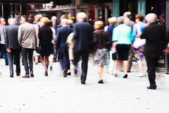 Crowd of dressed up people walking to a concert Stock Photo