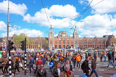 Crowd from dutch natives in Amsterdam at the Central Station at kingsday in the Netherlands Royalty Free Stock Photo