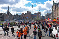 Crowd from dutch natives in Amsterdam at the Damrak in the Netherlands Royalty Free Stock Images
