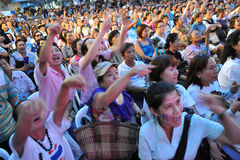Crowd at an Election Campaign Rally in Bangkok. Supporters of the Thai Democrat Party attend a general election campaign rally at Ratchaprasong in the city Stock Photo