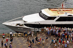 Crowd Embarking on Cruise Boat. Many people, a crowd, embarking on a Sydney Harbour day cruise boat, Circular Quay, Sydney, Australia stock photography