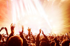Crowd enjoying concert. Happy people jumping, large group celebrating new year holiday, party background fun concept Stock Photography