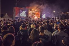 Crowd enjoying great festival party. Concert at night Royalty Free Stock Photo