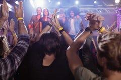Crowd enjoying at nightclub. During music festival Stock Image