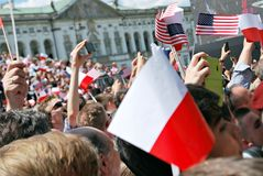 Crowd enthusiastically wave flags Stock Image