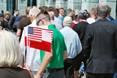 Crowd enthusiastically wave flags Royalty Free Stock Photography