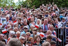 Crowd enthusiastically wave flags Royalty Free Stock Image