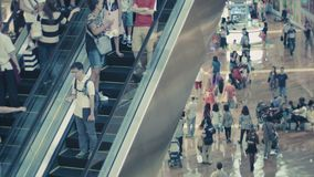 A crowd on the escalator in the shopping area of Marina Bay Sands. New Year shopping