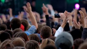 Crowd of fans cheering at open air festival stock video