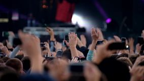Crowd of fans cheering at open air festival stock footage