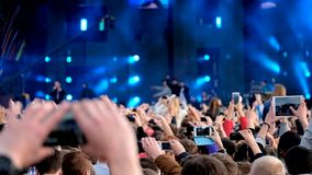 Crowd of fans cheering at open air festival stock video footage