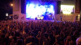 Crowd of fans cheering at open air live festival stock video