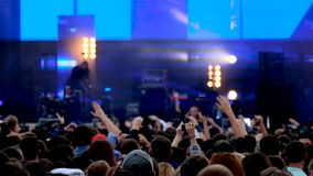 Crowd of fans cheering at open air live festival stock footage