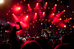 Crowd of fans at a concert. Crowd of fans at an open-air live concert Stock Photos