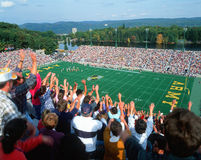 Crowd at Football Game. Crowd doing the wave at a college football game in Michie Stadium, New York Stock Image