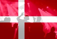 Football fans with blending Denmark flag. Crowd of football, soccer fans with raised arms with blending Denmark flag Royalty Free Stock Photo