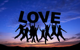 Crowd of friends jumping with LOVE on blue sky Stock Image