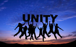 Crowd of friends jumping with UNITYon blue sky Royalty Free Stock Photography