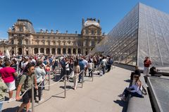 Crowd in front of the entrance to the Louvre museum royalty free stock photography