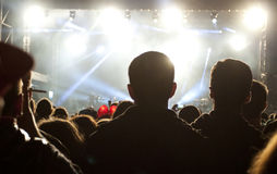 Crowd in front of stage lights Royalty Free Stock Images