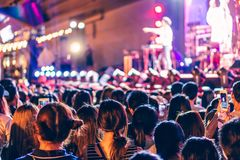 Audience at live concert. Crowd in front of stage at music festival royalty free stock images