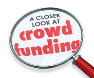 Crowd Funding Closer Look Magnifying Glass Words. Crowd Funding words under a magnifying glass for a closer look at investing through internet websites to Stock Photo