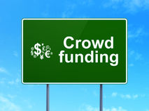 Crowd Funding and Finance Symbol on road sign Royalty Free Stock Images