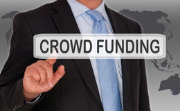Crowd Funding - Manager with touchscreen. On world map background stock photography