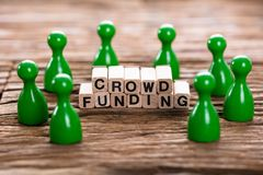 Crowd Funding Word Made With Wooden Blocks Royalty Free Stock Image