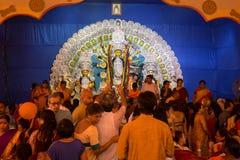 Crowd gathered inside a Durga Puja pandal to offer prayer to Goddess Durga. Stock Image
